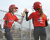 Ali Verdi #15 of MacArthur, left, congratulates #4 Ashley Budrewicz after she scored in the top of the seventh inning to extend their team's lead over Oceanside to 4-2 in a Nassau County varsity softball game at Oceanside High School on Thursday, Mar. 31, 2016. MacArthur went on to win 5-2.