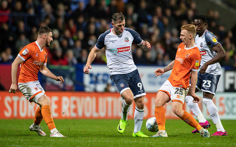 Bolton Wanderers' Daryl Murphy (centre) competing with Blackpool's Callum Guy (2nd right) <br /> <br /> Photographer Andrew Kearns/CameraSport<br /> <br /> The EFL Sky Bet League One - Bolton Wanderers v Blackpool - Monday 7th October 2019 - University of Bolton Stadium - Bolton<br /> <br /> World Copyright © 2019 CameraSport. All rights reserved. 43 Linden Ave. Countesthorpe. Leicester. England. LE8 5PG - Tel: +44 (0) 116 277 4147 - admin@camerasport.com - www.camerasport.com