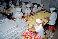 Weighing and packaging potato chips