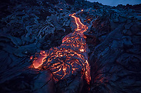 A close-up of a lava river, whose cooling black surface looks blue at dusk, Pulama Pali, Hawai'i Volcanoes National Park, Puna, Hawai'i Island, December 2017.