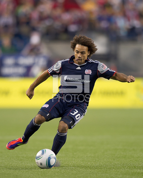 New England Revolution defender Kevin Alston (30) traps the ball. In a Major League Soccer (MLS) match, the New England Revolution tied Toronto FC, 0-0, at Gillette Stadium on June 15, 2011.