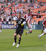 Chivas USA defender Mariano Trujillo (8) goes up to defend the play against DC United forward Danny Allsopp (9).  DC United defeated Chivas USA 3-2 at RFK Stadium, Saturday May 29, 2010.