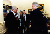 United States President Bill Clinton meets with Prime Minister Binyamin Netanyahu and Palestinian Authority Chairman Yasser Arafat in the Oval Office in the White House in Washington, D.C. on Thursday, October 15, 1998.  Pictured from left to right: Prime Minister Netanyahu; Chairman Arafat; Gamal Helal, the Interpreter; President Clinton; Secretary of State Madeleine Albright..Mandatory Credit: Barbara Kinney / White House via CNP