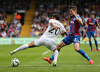 Pictured: Joel Ward of Crystal Palace (R) against Jefferson Montero of Swansea (L)<br />
