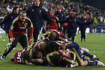 22 November 2009: Salt Lake's Robbie Russell (GHA) is tackled by teammates after making the championship winning penalty kick. Real Salt Lake defeated the Los Angeles Galaxy 5-4 on penalty kicks after the teams played to a 1-1 overtime tie at Qwest Field in Seattle, Washington in MLS Cup 2009, Major League Soccer's championship game.