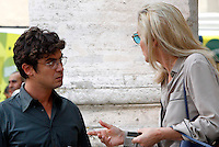 "L'attore Riccardo Scamarcio e l'attrice statunitense Sharon Stone, a destra, sul set del film ""Un ragazzo d'oro"", all'esterno della chiesa di Santa Maria dei Miracoli in piazza del Popolo, Roma, 18 luglio 2013.<br /> Italian actor Riccardo Scamarcio and U.S. actress Sharon Stone, right, on the set of the movie ""Un ragazzo d'oro"", outside of the church of St. Mary of Miracles in downtown Rome, 18 July 2013.<br /> UPDATE IMAGES PRESS/Riccardo De Luca"