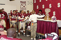 The team celebrates with the Legends Trophy after Stanford's 17-13 victory over Notre Dame on November 24, 2001 at Stanford Stadium.<br />Photo credit mandatory: Gonzalesphoto.com