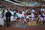 West Ham United 2 Crystal Palace 2, 02/04/2016. Boleyn Ground, Premier League. The two teams walking on to the pitch at the Boleyn Ground before West Ham United (in claret and blue) hosted Crystal Palace in a Barclays Premier League match. The Boleyn Ground at Upton Park was the club's home ground from 1904 until the end of the 2015-16 season when they moved into the Olympic Stadium, built for the 2012 London games, at nearby Stratford. The match ended in a 2-2 draw, watched by a near-capacity crowd of 34,857. Photo by Colin McPherson.