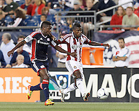 Chivas USA midfielder Miller Bolanos (17) attempts to control the ball as New England Revolution midfielder Clyde Simms (19) pressues. In a Major League Soccer (MLS) match, the New England Revolution tied Chivas USA, 3-3, at Gillette Stadium on August 29, 2012.