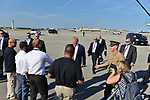 WEST PALM BEACH, FL - FEBRUARY 17: U.S. President Donald J. Trump walking with a military soldier and shake hand with supporters after arrives on Air Force One at the Palm Beach International airport as they prepare to spend part of the weekend at Mar-a-Lago resort on February 17, 2017 in West Palm Beach, Florida. After touring and meeting with Dennis Muilenburg Chairman of the Board, President, and CEO of the Boeing Company in North Charleston, South Carolina.  President Trump schedule to hold a campaign rally tomorrow at Melbourne Florida. ( Photo by Johnny Louis / jlnphotography.com )