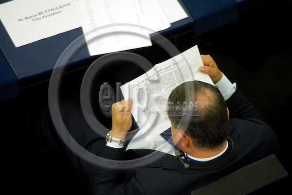 STRASBOURG - FRANCE - 26 OCTOBER 2004 --Rocco BUTTIGLIONE, Italian Commissioner designate in charge of Justice, Freedom and Security, reading a copy of a German newspaper during the debate on the new EU commission in the EU Parliament the day before the vote.-- PHOTO: ERIK LUNTANG / EUP-IMAGES