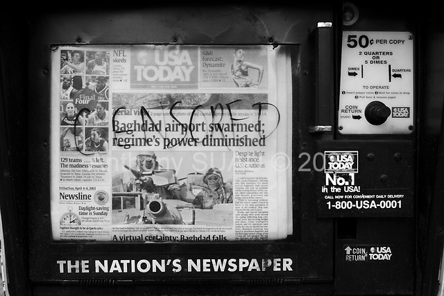 Madison, Wisconsin.USA.Apirl 6, 2003..Defaced newspaper stands on the University of Wisconson campus.