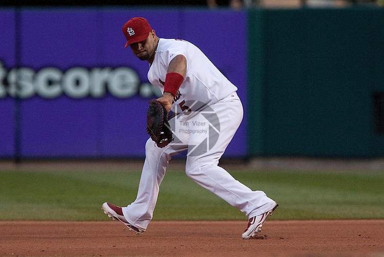 June 19, 2010       St. Louis Cardinals first baseman Albert Pujols (5) fields a bouncing grounder.  The St. Louis Cardinals defeated the Oakland Athletics 4-3 in the second game of a three-game homestand at Busch Stadium in downtown St. Louis, MO on Saturday June 19, 2010.