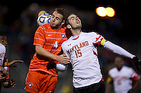 Jack Metcalf (4) of Clemson goes up for a header in the box with Patrick Mullins (15) of Maryland during the game at the Maryland SoccerPlex in Germantown, MD. Maryland defeated Clemson, 1-0, in overtime.  With the win the Terrapins advanced to the finals of the ACC men's soccer tournament.