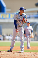 Jacksonville Jumbo Shrimp relief pitcher Jorgan Cavanerio (18) looks in for the sign during a game against the Biloxi Shuckers on May 6, 2018 at MGM Park in Biloxi, Mississippi.  Biloxi defeated Jacksonville 6-5.  (Mike Janes/Four Seam Images)
