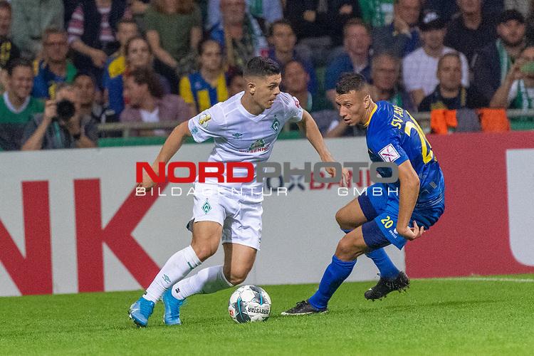 10.08.2019, wohninvest Weserstadion, Bremen, GER, DFB-Pokal, 1. Runde, SV Atlas Delmenhorst vs SV Werder Bremen<br /> <br /> DFB REGULATIONS PROHIBIT ANY USE OF PHOTOGRAPHS AS IMAGE SEQUENCES AND/OR QUASI-VIDEO.<br /> <br /> im Bild / picture shows<br /> <br /> Milot Rashica (Werder Bremen #07)<br /> Oliver Rauh (SV Atlas Delmenhorst #20)<br /> Foto © nordphoto / Kokenge
