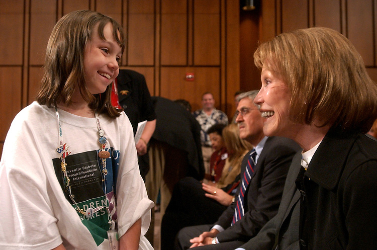 diabetes4/062403 - Abby Wolter, 8, of Alton, Ill., speaks to Actress and C.hairman of the Juvenile Diabetes Research Foundation, Mary Tyler Moore during a hearing in which 200 children appeared to remind Congress and the Administration of the critcal need to find a cure for juvenile diabetes, from which all the children suffer.  Moore testified on behalf of the Juvenile Diabetes Research Foundation, because she has suffered with the disease since the 60's.