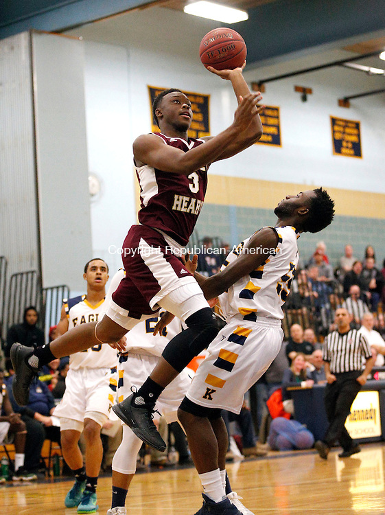 Waterbury, CT- 02 February 2016-020216CM07-  Sacred Heart's Mustapha Heron goes to the hoop against Kennedy's Victor Sampson during their NVL matchup in Waterbury on Tuesday.  The Hearts would go onto win,95-71.     Christopher Massa Republican-American