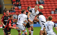 Aviva Premiership Rugby Saracens v Sale Sharks from Vicarage Road, Watford, England. 11th September 2010.  Carl Fearns of Sale Sharks clears the ball to Dwayne Peel of Sale Sharks.