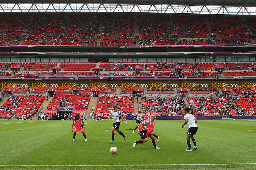 GB players warm up before kick-off - Great Britain Women vs Brazil Women - Womens Olympic Football Tournament London 2012 Group E at Wembley Stadium, London - 31/07/12 - MANDATORY CREDIT: Gavin Ellis/SHEKICKS/TGSPHOTO - Self billing applies where appropriate - 0845 094 6026 - contact@tgsphoto.co.uk - NO UNPAID USE.