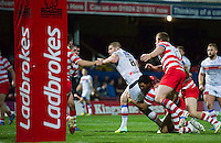 Picture by Allan McKenzie/SWpix.com - 17/04/2015 - Rugby League - Ladbrokes Challenge Cup - Wakefield Trinity Wildcats v Halifax RLFC - Rapid Solicitors Stadium, Wakefield, England - Wakefield's Nick Scruton is tackled just short of the try line by Halifax, Ladbrokes, branding.