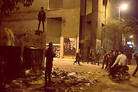 EGYPT / Cairo / 27.11.2012 / Young protesters on a wall in Mohamed Mahmoud Street just nearby Tahrir square, where thousands of people have gathered to protest President Morsy's above-the-law constitutional declaration © Giulia Marchi