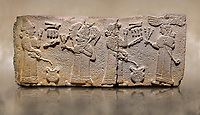 Aslantepe Monumental Hittite relief sculpted orthostat stone panel.  Limestone, Aslantepe, Malatya, 1200-700 B.C. <br /> Scene of the king's offering drink and sacrifice to the gods. The king offers to the winged god of the moon who stands across and holds a lightning bundle in his hand. Behind the king is the queen, who also offers to goddess of the sun holding a sceptre in his hand. King's left hand is in a position to worship.