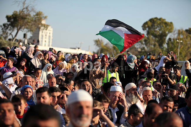Palestinians attend a a mass wedding ceremony in Gaza City, on May 31, 2015. Nearly 2000 Palestinian couples were married in a ceremony funded by the Turkish government and supported by the Hamas movement. Photo by Ashraf Amra