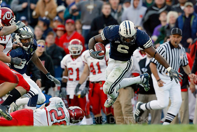 Provo, Ut --11/19/2005--5:08:56 PM.BYU's Curtis Brown is tripped up during a run in the third quarter...Utah at BYU LaVell Edwards stadium. Utah WON 41-34 in overtime. ...Photo by: Chris Detrick/The Salt Lake Tribune.File #_J9A8533
