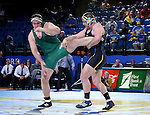 BROOKINGS, SD - FEBRUARY 4:  Alex Macki from South Dakota State controls the leg of Dustin Denison from Utah Valley during their heavyweight pound match at Frost Arena Saturday night. (Photo by Dave Eggen/Inertia)