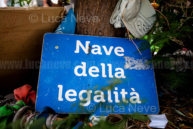 """Palermo (Sicily - Italy), 19/07/2017. """"Basta depistaggi e omertà di Stato!"""" (""""Stop disinformation and omertá by the State!"""") (1). Public event to commemorate the 25th Anniversary of the assassination of the anti-mafia Magistrate Paolo Borsellino along with five of his police """"scorta"""" (Escorts from the special branch of the Italian police force who protect Judges): Agostino Catalano, Emanuela Loi (The first Italian female member of the police special branch and the first woman of this branch to be killed on duty), Vincenzo Li Muli, Walter Eddie Cosina and Claudio Traina. The event was held at Via D'Amelio, the road where Borsellino was killed. Family members of mafia victims, amongst others, made speeches about their dramatic experiences, mafia violence and unpunished crimes, State cover-ups, silence ('omertá'), and misinformation. Speakers included, amongst others, Vincenzo Agostino & Augusta Schiera, Salvatore & Cristina & Antonella Catalano, Graziella Accetta & Ninni Domino, Massimo Sole, Paola Caccia, Luciano Traina, Gianluca & Angela Manca, Nunzia & Stefano Mormile, Ferdinando Imposimato, Judge Nino Di Matteo. The event ended with the screening of the RAI docu-fiction, 'Adesso Tocca A Me' ('Now it's My Turn' - Watch it here: http://bit.ly/2w3WJUX ) by G. Filippetto & F. Miccichè.<br /> <br /> For more info & a video of the event please click here: http://bit.ly/2eQfNT3 & http://bit.ly/2eQbmrj & http://19luglio1992.com & http://bit.ly/2he8hCj<br /> <br /> (1) 'Omerta' is the term used in Italy to refer to the code of silence used by mafia organisations, as well as the culture of silence that is entrenched in society at large (especially among victims of mafia crimes, as they fear recriminations), about the existence of organised crime and its activities."""