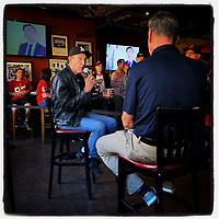 """SAN FRANCISCO, CA - AUGUST 7:  iPhone Instagram of photographer Michael Zagaris doing a live interview promoting the new book """"Letters to 87"""" about Dwight Clark with KNBR's Brian Murphy at the book launch party at Pete's Tavern on August 7, 2019 in San Francisco, California. (Photo by Brad Mangin)"""
