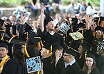 Graduates wave to their families during the 45th annual Western Nevada College Commencement ceremony in Carson City, Nev., on Monday, May 23, 2016. A record 556 graduates received 598 degrees.<br />