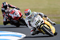 PHILLIP ISLAND, 26 FEBRUARY - Jakub Smrz (CZE) riding the Ducati 1098R (96) of the Team Effenbert - Liberty Racing leads Joshua Waters (AUS) riding the Suzuki GSX-R1000 (12) of the YOSHIMURA SUZUKI Racing Team into the corner during Superpole qualifying for round one of the 2011 FIM Superbike World Championship at Phillip Island, Australia. (Photo Sydney Low / syd-low.com)