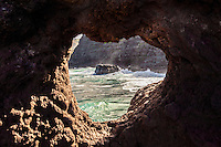 A view of the ocean through a heart-shaped opening in a rock near the Nakalele blowhole at Nakalele Point, northwestern Maui.