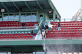 Workers cleared snow from the seats in preparation for Saturday's games. -  - The participating teams in Hockey East's first doubleheader during Frozen Fenway practiced on January 3, 2014 at Fenway Park in Boston, Massachusetts.