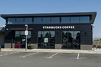 Pictured: A general view of Starbucks on Fabian Way in Swansea during the Covid-19 Coronavirus pandemic in Wales, UK, Swansea, Wales, UK. Monday 23 March 2020