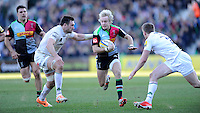 Charlie Walker of Harlequins looks for a gap between Tom Guest and Eoin Griffin of London Irish during the Aviva Premiership Rugby match between Harlequins and London Irish at The Twickenham Stoop on Saturday 7th March 2015 (Photo by Rob Munro)