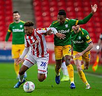 12th February 2020; Bet365 Stadium, Stoke, Staffordshire, England; English Championship Football, Stoke City versus Preston North End; Tyrese Campbell of Stoke City holds off Darnell Fisher of Preston North End