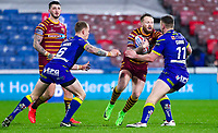Picture by Alex Whitehead/SWpix.com - 08/02/2018 - Rugby League - Betfred Super League - Huddersfield Giants v Warrington Wolves - John Smith's Stadium, Huddersfield, England - Huddersfield's Jordan Rankin is tackled by Warrington's Ben Currie.