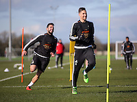 Pictured L-R: Jordi Amat chases Federico Fernandez Thursday 25 February<br />Re: Swansea City FC training at Fairwood, near Swansea, Wales, UK, ahead of their game against Tottenham Hotspur.