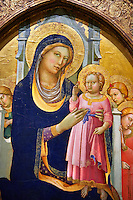 "Gothic Altarpiece of Madonna and Child enthroned with angels byPero di Giovanni known as ""Lorenzo Monaco"" of Sienna and Florence, circa 1415-1420, tempera and gold leaf on wood. National Museum of Catalan Art, Barcelona, Spain, inv no: MNAC 212808.<br /> <br /> The Virgin Mary is seated with the child standing on her lap, in an attitude of blessing, accompanied by angels with incentives. The composition is very simple and fuses Sienese and Florentine pictorial traditions in the style of Lorenzo Monaco, monk of the convent of Santa Maria degli Angeli in Florence and the last representative of the style of Giotto before the Renaissance revival of Fra Angelico."