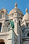 Equestrian statue of Saint Louis on the outside of the white church, Sacre-Coeur; the church was built as a memorial for the soliders killed during the Franco-Prussian War and took 38 years to build