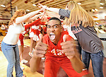 Glen Burnie's Brandon Spain gives two thumbs up as he and his teammates run through a tunnel of cheerleaders and fans after defeating Broadneck 54-64.