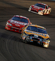 Apr 22, 2006; Phoenix, AZ, USA; Nascar Nextel Cup driver Matt Kenseth of the (17) DeWalt Ford Fusion leads Dale Earnhardt Jr. and Kasey Kahne during the Subway Fresh 500 at Phoenix International Raceway. Mandatory Credit: Mark J. Rebilas-US PRESSWIRE Copyright © 2006 Mark J. Rebilas..