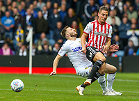 Leeds United's Stuart Dallas is tackled by Brentford's Sergi Canos<br /> <br /> Photographer Alex Dodd/CameraSport<br /> <br /> The EFL Sky Bet Championship - Leeds United v Brentford - Saturday 6th October 2018 - Elland Road - Leeds<br /> <br /> World Copyright &copy; 2018 CameraSport. All rights reserved. 43 Linden Ave. Countesthorpe. Leicester. England. LE8 5PG - Tel: +44 (0) 116 277 4147 - admin@camerasport.com - www.camerasport.com