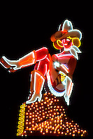 Neonlight Cowgirl sign in Las Vegas gambling city in Nevada, USA