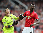 Manchester United's Paul Pogba with West Ham's Joe Hart during the premier league match at Old Trafford Stadium, Manchester. Picture date 13th August 2017. Picture credit should read: David Klein/Sportimage