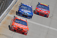 Jun 1, 2008; Dover, DE, USA; NASCAR Sprint Cup Series driver Kyle Busch (18) leads Kurt Busch (2) and Jeff Gordon (24) during the Best Buy 400 at the Dover International Speedway. Mandatory Credit: Mark J. Rebilas-US PRESSWIRE