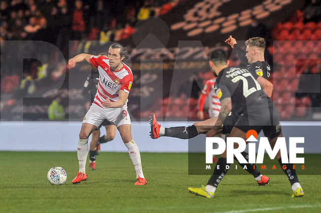 Doncaster Rovers forward John Marquis (9) during the Sky Bet League 1 match between Doncaster Rovers and Barnsley at the Keepmoat Stadium, Doncaster, England on 15 March 2019. Photo by Stephen Buckley / PRiME Media Images.